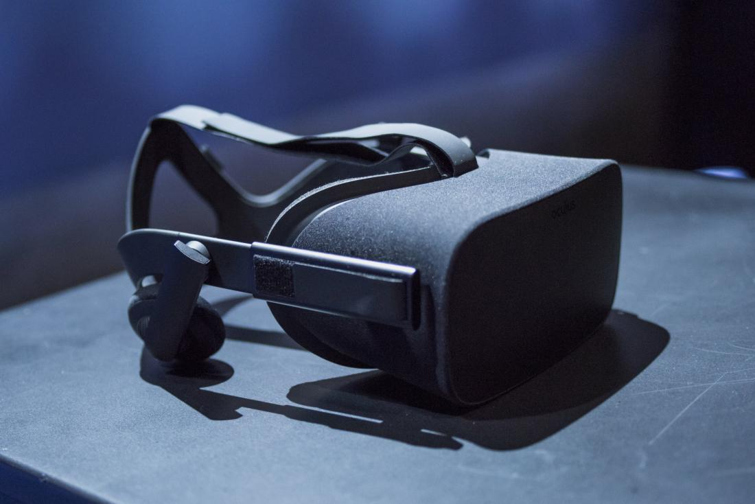"""The Oculus Rift is arranged for a photograph during the Oculus VR Inc. """"Step Into The Rift"""" event in San Francisco, California, U.S., on Thursday, June 11, 2015. Facebook Inc.'s Oculus virtual-reality headsets will work with Microsoft Corp.'s Windows 10 and use the software maker's wireless Xbox game controller. Photographer: David Paul Morris/Bloomberg *** Local Caption *** Palmer Luckey"""